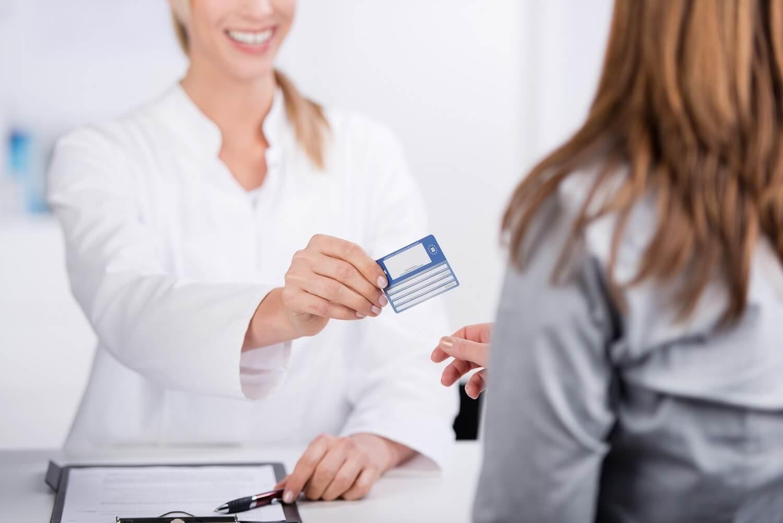 doctor handing customer ehic