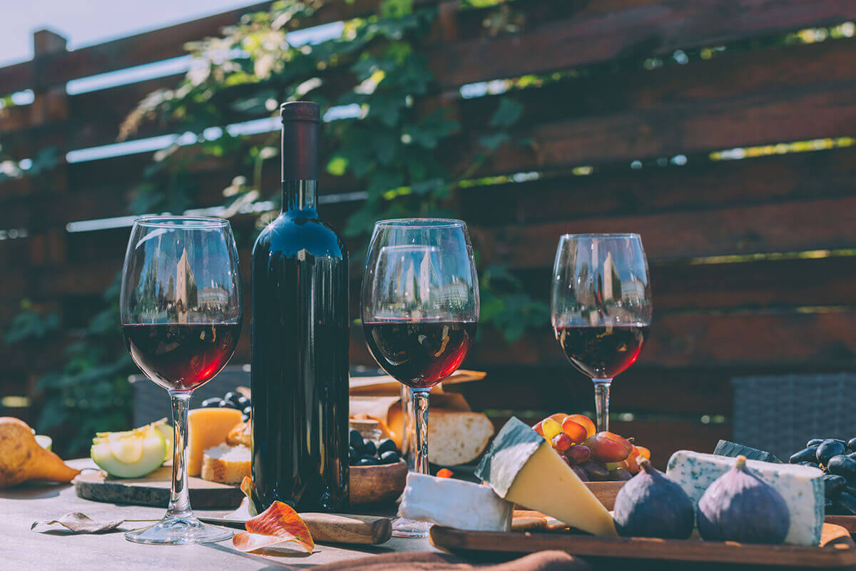 wine and cheese on table outdoors