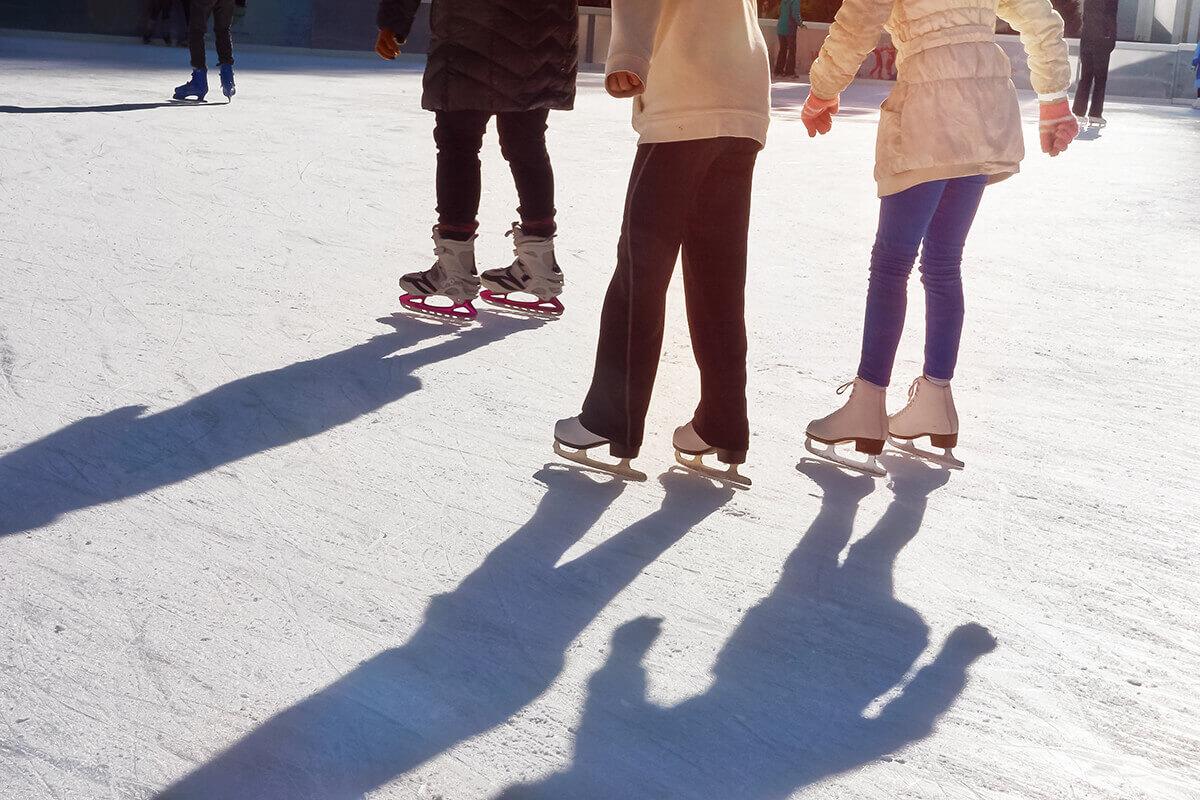 friends ice skating at Christmas