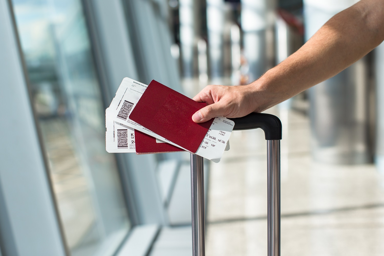 man passport luggage