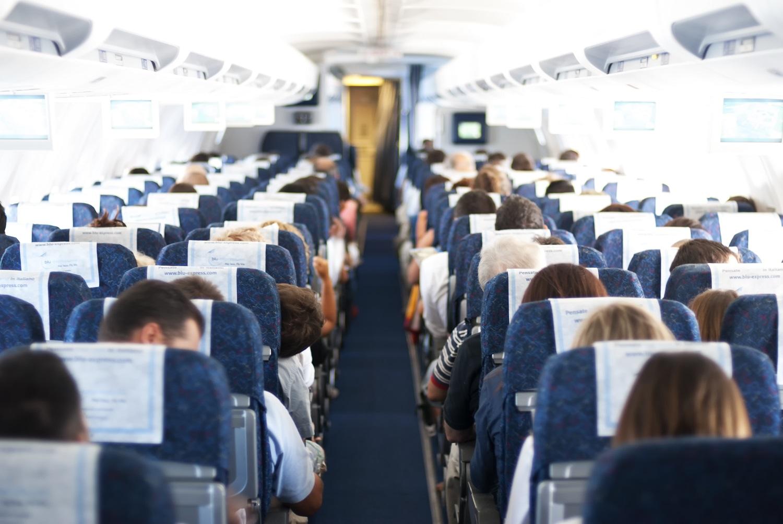 passengers on plane aisle