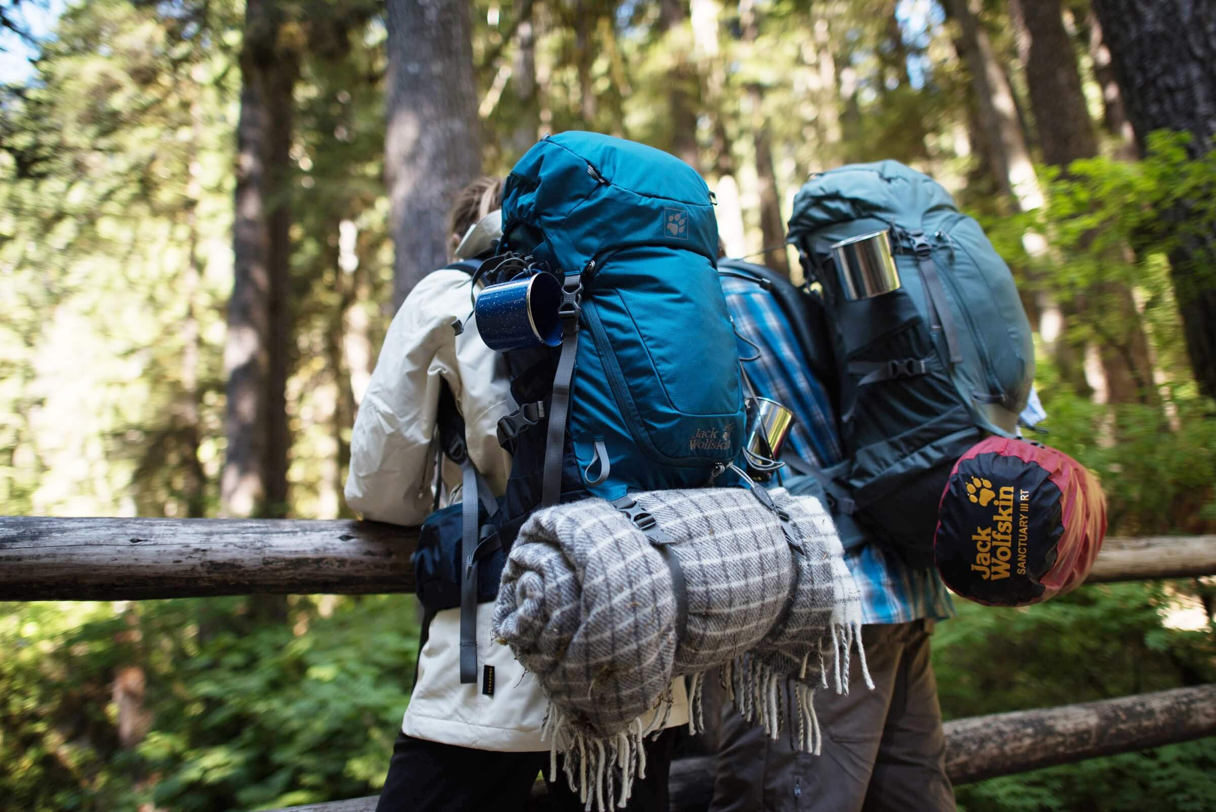 backpacking couple woods bag