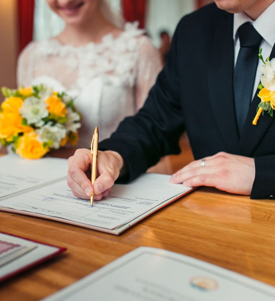 Married couple signing paperwork