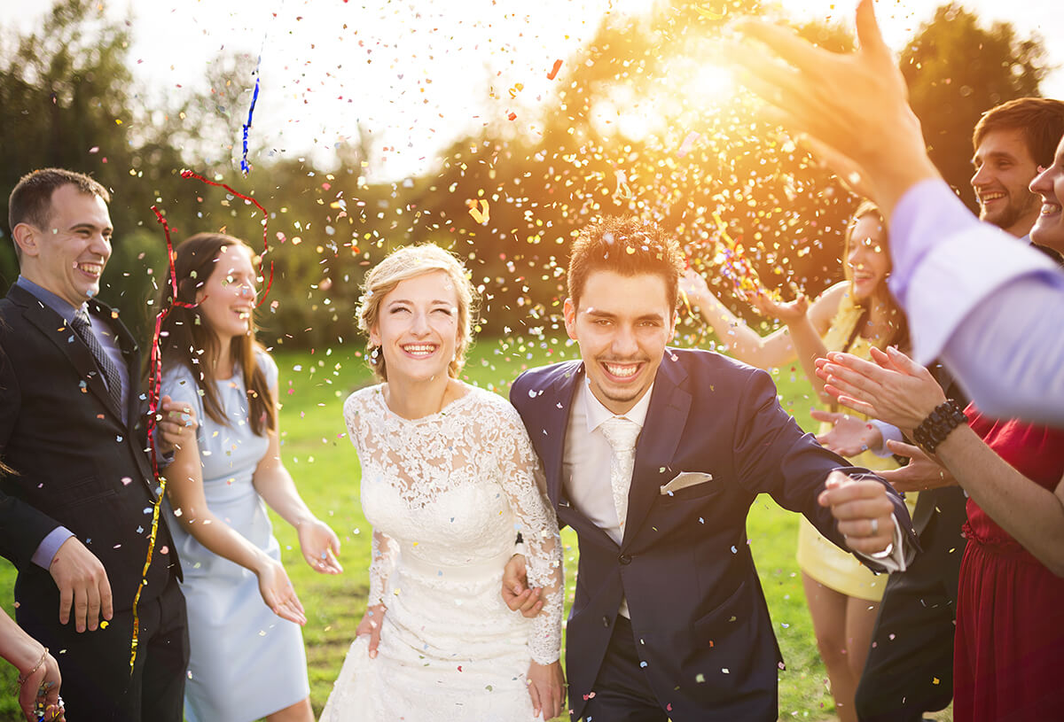 recently married couple being covered in confetti